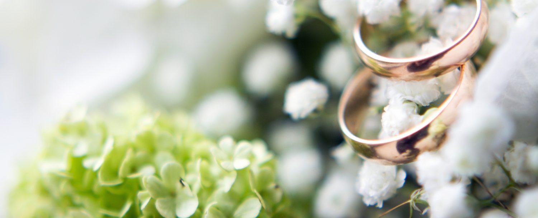 Wedding rings on bride bouquet.